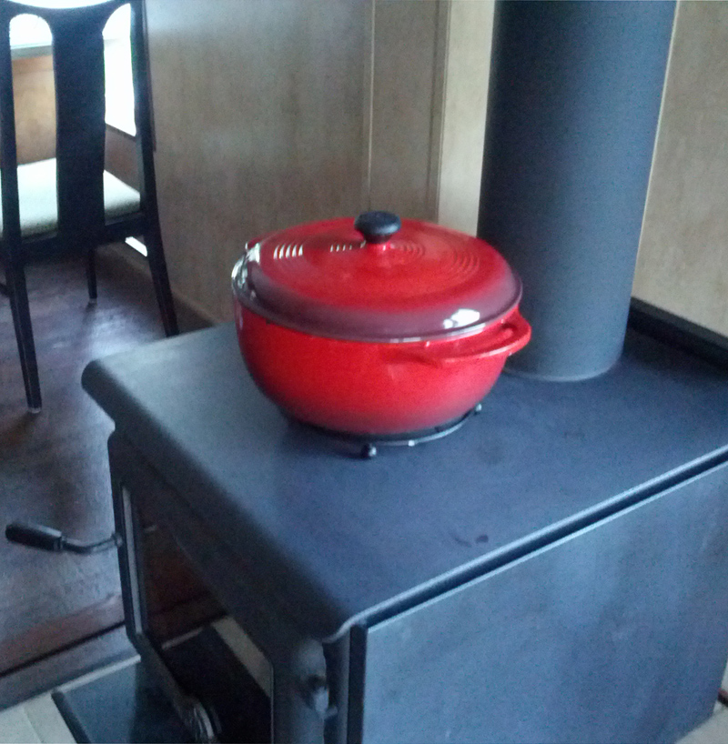 My Lodge enamel dutch oven sitting on top of a trivet. - How To Cook On A Woodstove: On Top And Inside - Modern